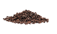 Pile cocoa nibs.  Starting ingredient to make homemade chocolate.