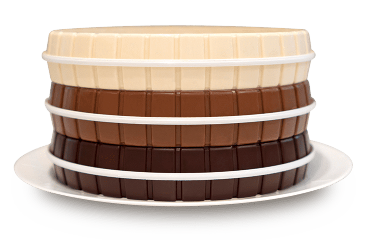 Stacked rings of dark, milk and white chocolate molded with the CocoTerra. Design. Decorate. Share.